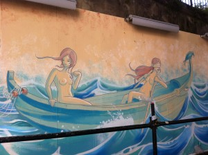Street art Lisbon - Two nude women row a boat