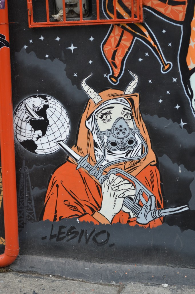 global oil graffiti bogota with sad demonic nun holding gas nozzle that pierces the planet earth.