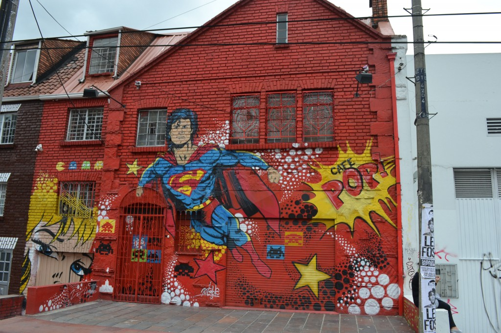 Graffiti mural in Bogota with superman and classic comic sound affects. Sign says Cafe Pop!